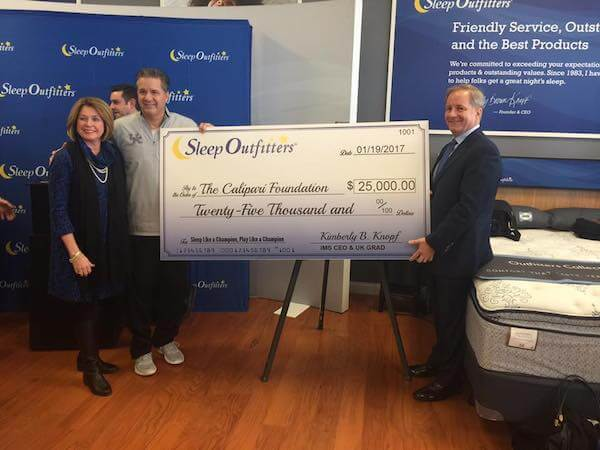 sleep outfitters presents check for $25,000