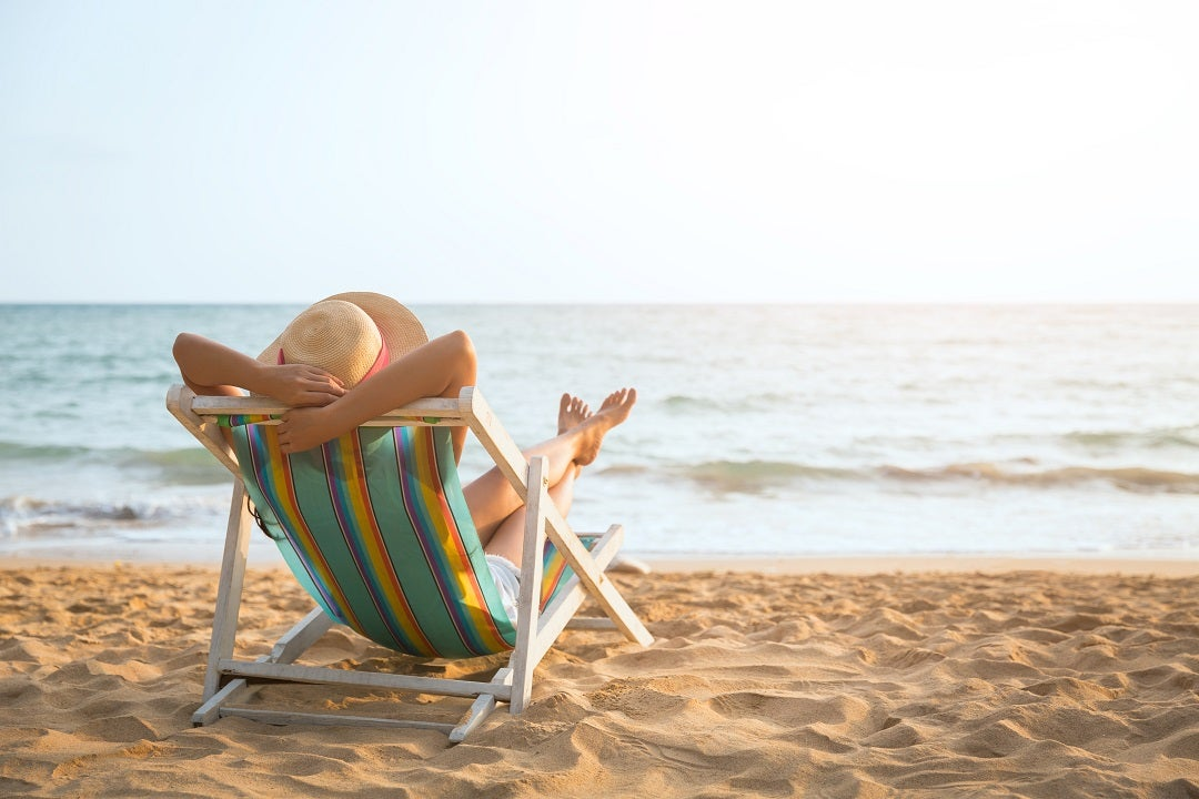 Girl sleeping on beach chair