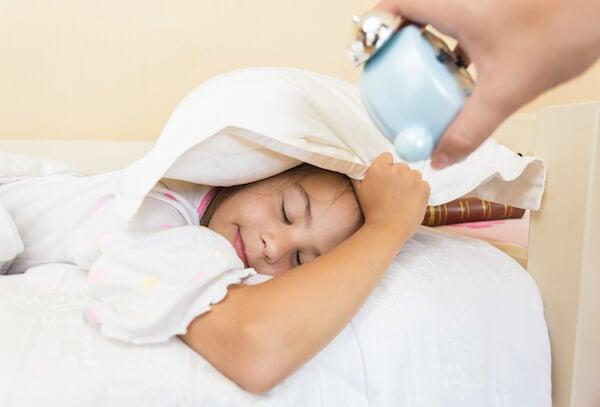 child with alarm clock