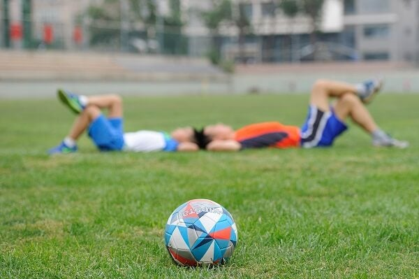 soccer players resting