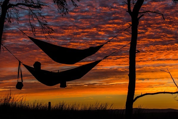 two hammocks at sunset