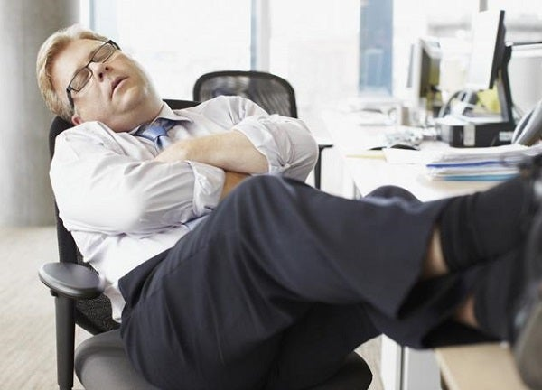 man napping at desk